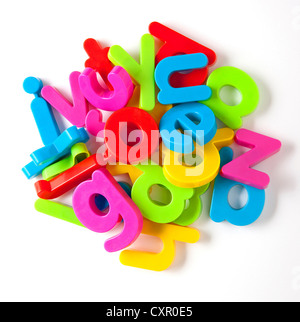 Alphabet fridge magnets in a pile - Stock Photo