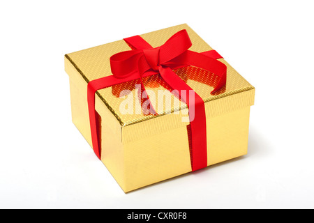 Golden gift box with red ribbon - Stock Photo