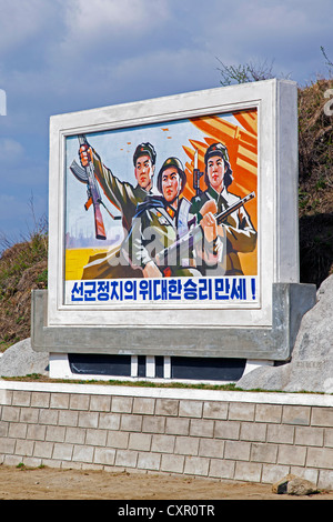 Democratic Peoples's Republic of Korea (DPRK), North Korea, propaganda poster in the countryside between Wonsan - Stock Photo