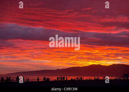 People on beach at sunset, santa monica, california, usa - Stock Photo