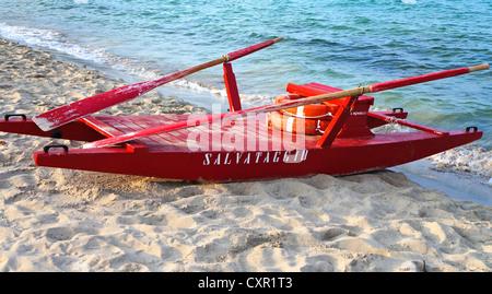 Red rescue boat on the beach of Mondello in Palermo,Sicily - Stock Photo