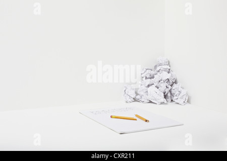Broken pencil, notebook and crumpled paper - Stock Photo