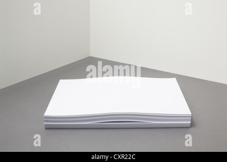 Stack of paper with something inside - Stock Photo