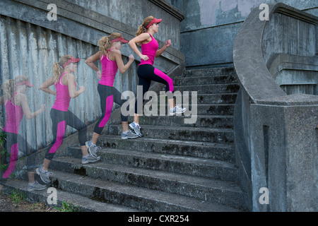 Young woman running up stairs, multiple image - Stock Photo