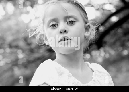 Little girl looking at camera - Stock Photo