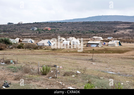 A tent village for Syrian refugees in the northern Lebanese region of Wadi Khaled, just south of the Syria-Lebanon - Stock Photo