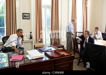 US President Barack Obama talks on the phone with House Minority Leader Nancy Pelosi and Senate Majority Leader Harry Reid July 31, 2011 in Chief of Staff Bill Daley's West Wing Office at the White House to discuss ongoing efforts in the debt limit and deficit reduction talks. Chief of Staff Bill Daley, National Economic Council Director Gene Sperling, and Treasury Secretary Timothy Geithner.