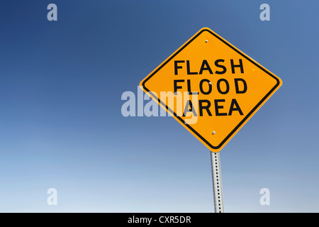 Warning sign, Flash Flood Area, danger of flash floods on a desert road in Nevada, USA - Stock Photo
