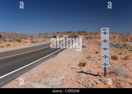 Warning sign, danger of flash floods on a desert road in Nevada, USA - Stock Photo