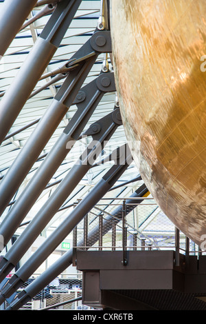 Detail shot of the hull and cantilevered arms which suspend the Cutty Sark ship in dry dock - Stock Photo