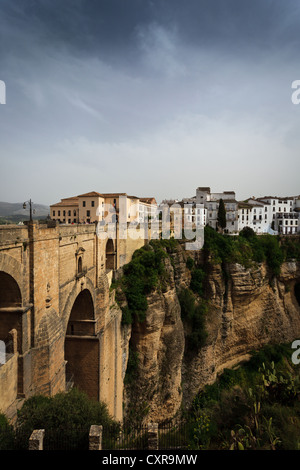 View of buildings on cliff in new town from other side of the 18th century bridge over 300 ft  deep Tajo Gorge in - Stock Photo