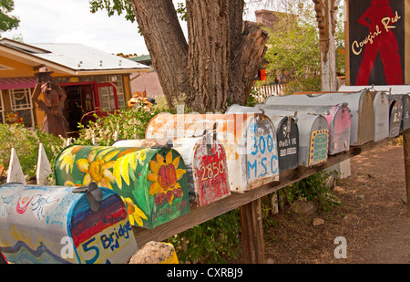 A row of colorful mailboxes in Madrid, New Mexico, along the Turquoise Trail - Stock Photo