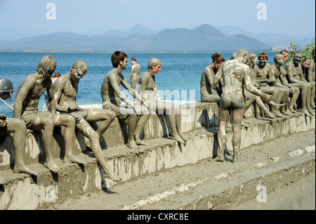 People taking a mud bath, spa on Lake Koycegiz, Sultaniye, near Dalyan, Mugla Province, Turkey, Asia Minor - Stock Photo