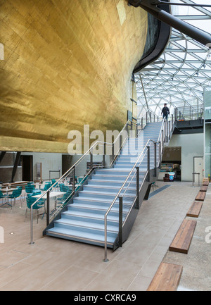 The restored Cutty Sark tea clipper with golden hull - Stock Photo