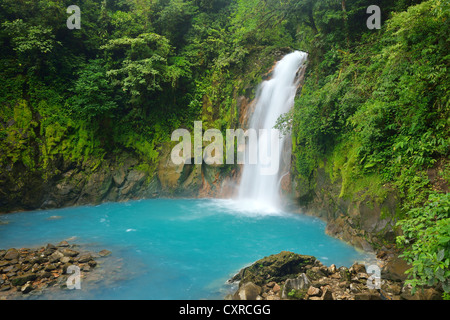 Waterfall at the light blue coloured river Rio Celeste, Tenorio Volcano National Park, Costa Rica, Central America - Stock Photo