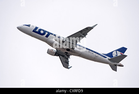 LOT Embraer 170-200LR airplane after takeoff from Munich Airport, Bavaria, Germany, Europe - Stock Photo