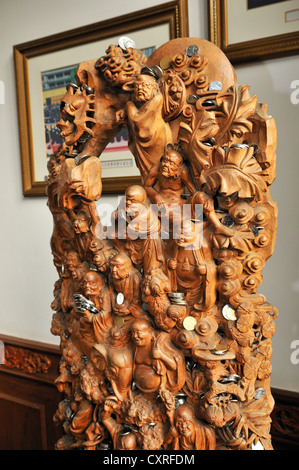 Carved Buddha sculptures with donated money, Jade Buddha Temple, Shanghai, China, Asia - Stock Photo