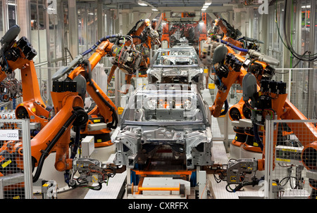 Industrial robots putting out car bodies on assembly line 2, Audi A4 Sedan, A4 Avant, A5 Coupe, A5 Sportback and - Stock Photo