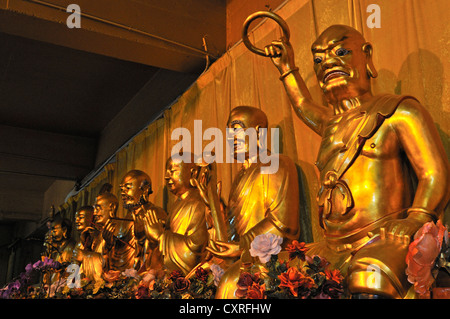 Golden Buddha statues in the Jing'an Temple, Shanghai, China, Asia - Stock Photo