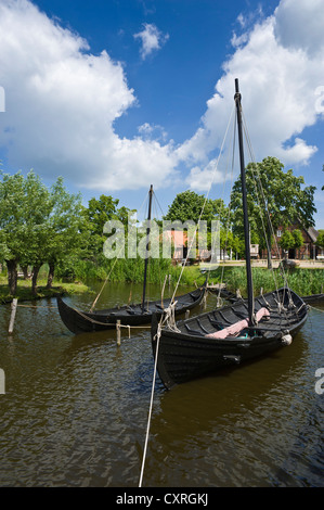 Wallmuseum, Slavic village with a Viking ship, a Slavic merchant ship and a logboat, Oldenburg in Holstein, Baltic - Stock Photo