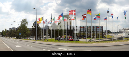 The national flags of the member states of the European Union in front of the building of the European Commission - Stock Photo