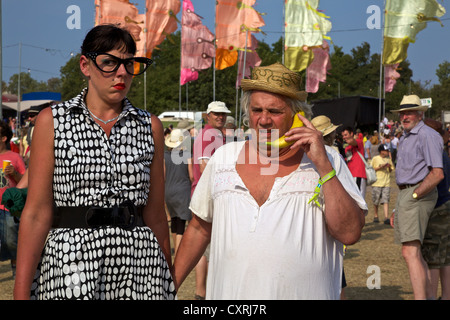 Performing Artists making a 'phone call' at the 2010 Glastonbury Festival of Contemporary and Performing Arts - Stock Photo
