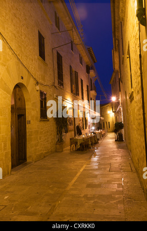 Café, restaurant in an alleyway of the old town of Alcudia, Mallorca, Majorca, Balearic Islands, Spain, Europe - Stock Photo