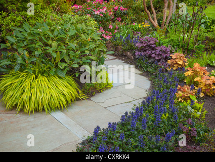 Vashon-Maury Island, WA: Pathway through a spring perennial garden - Stock Photo