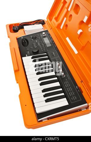 2006 Korg Micro X portable 25-key music synthesizer / controller in orange hard case - Stock Photo
