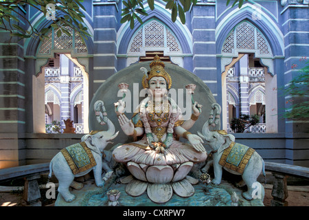 Laxmi or Lakshmi, Hindu goddess standing for happiness, beauty, harmony and prosperity, flanked by two elephants, - Stock Photo