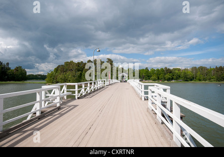 Bridge to Museum Island of Seurasaari, houses and other wooden architecture brought from all over Finland are on - Stock Photo