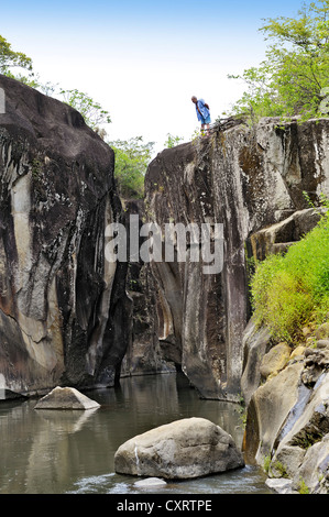Tourists at a gorge with a river near Liberia, Guanacaste province, Costa Rica, Central America - Stock Photo