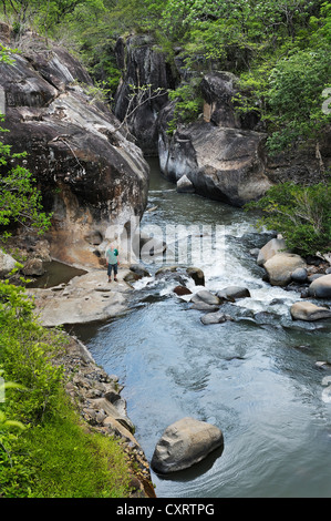 Tourists in a river gorge near Liberia, Guanacaste province, Costa Rica, Central America - Stock Photo