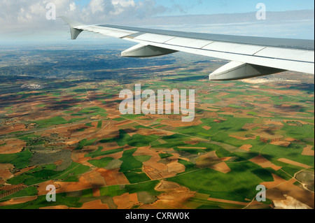 View from an airplane during the flight from Frankfurt to Madrid, Spanish fields and forests under the wing of the - Stock Photo