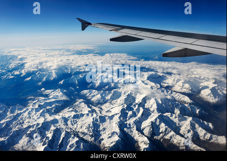 View from an airplane during the flight from Frankfurt to Madrid, French alps under the wing of the plane - Stock Photo