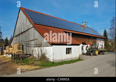 Farm with solar panels on the roof, near Diessen on Lake Ammer, Bavaria, Germany, Europe - Stock Photo