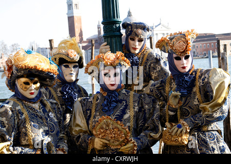Mask wearers, Carnival in Venice, Italy, Europe - Stock Photo