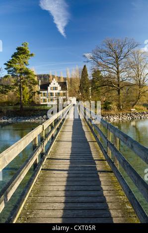 Wooden bridge across the Rhine river leading to Werd island, near Stein am Rhein, Eschenz, Canton of Thurgau, Switzerland - Stock Photo