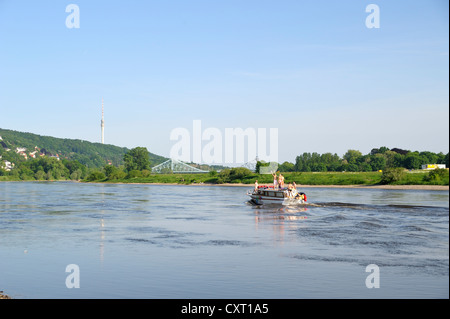 Boat with young people partying on the Elbe river, Blaues Wunder bridge at back, Dresden, Saxony, Germany, Europe, - Stock Photo