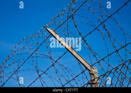 Barbed wire security fence around Geneva Airport, Switzerland - Stock Photo