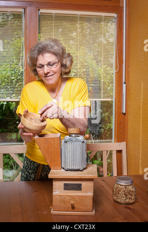 Nutritionist with a grain mill - Stock Photo