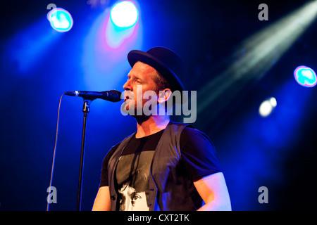 Bart van der Weide, singer of the Dutch band Racoon, performing live in the Schueuer concert hall, Lucerne, Switzerland, - Stock Photo
