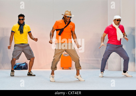 3 young men, models performing in the Spring and Summer Fashion Show 2012 in Pilatusmarkt in Kriens, Lucerne, Switzerland