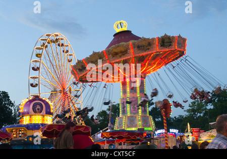 Swing caroussel and Ferris wheel at the Dult fun fair, Landshut, Bavaria, Germany, Europe - Stock Photo