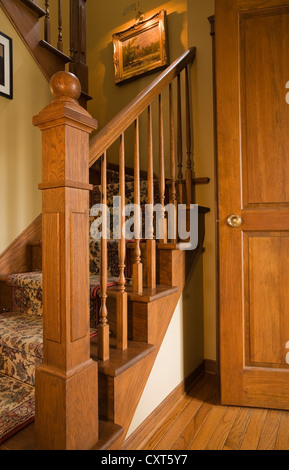 Staircase leading to the upstairs floor in a 1998 reproduction of an old Canadiana cottage-style residential home, - Stock Photo