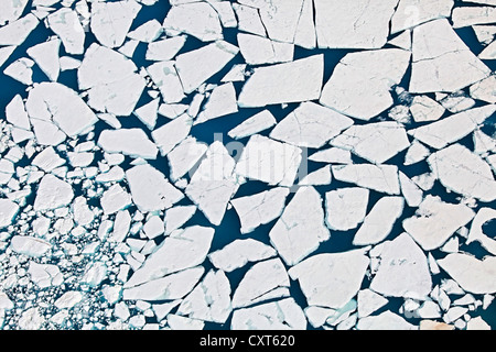 Aerial view of a blue lake on the Vatnajoekull glacier with ice floes, Iceland, Europe - Stock Photo