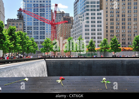 World Trade Center memorial, southern basin, the names of the victims are engraved in a bronze belt surrounding - Stock Photo