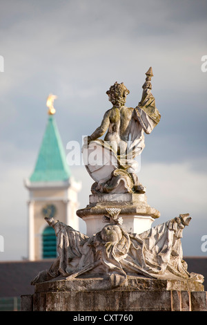 Statue in the gardens of Schloss Karlsruhe Castle with the tower of the Stadtkirche, town church, Karlsruhe, Baden - Stock Photo