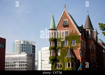 Old warehouse in the Speicherstadt district, modern architecture of the HafenCity district at the back, Free and - Stock Photo