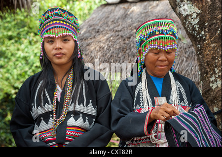 Traditionally dressed women from the Black Hmong hill tribe, ethnic minority from East Asia, doing needlework, embroidery - Stock Photo